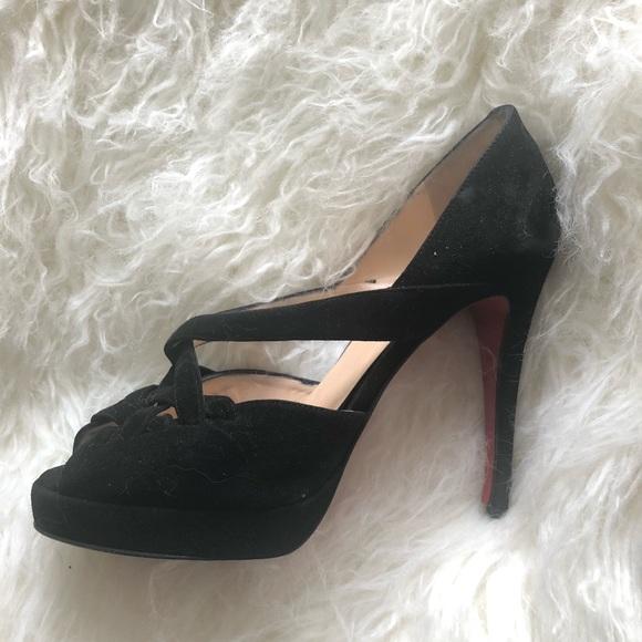 on sale adb2c 9636f Iconic black suede Christian Louboutin pumps